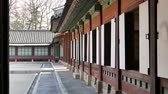 Seoul, Korea - December 9, 2015: opened doors of a building in Changdeokgung. Changdeokgung is a palace built as a secondary palace of the Joseon dynasty in 1405, during King Taejongs reign.