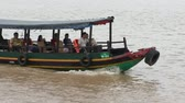 VIETNAM, MEKONG DELTA, 31 JULY 2014 - People at the traditional vietnamese boat for transporting tourists on Mekong River, Vietnam