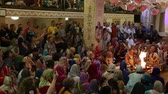 Hare Krishna followers sing mantra at the ceremony in Hare Krishna Temple, Moscow, Russia, 8 May 2017