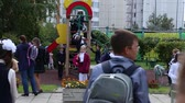 RUSSIA, MOSCOW, 1 SEPTEMBER 2016 - Children in the school uniform at the playground at the secondary school Dostupné videozáznamy