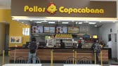 BOLIVIA, LA PAZ, 13 FEBRUARY 2017 - People buy food in the Famous Pollos Copacabana fast food restaurant in La Paz, Bolivia, South America Dostupné videozáznamy