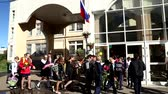 RUSSIA, MOSCOW, 1 SEPTEMBER 2016 - Happy children with bouquets of flowers go to secondary school at the Day of Knowledge Dostupné videozáznamy