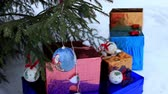 christmass : Pile of gifts under Christmass tree on the snow Stock Footage