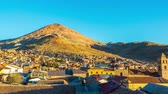 américa latina : Sun setting over Potosi, Bolivia with Cerro Rico in the background Stock Footage