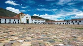 VILLA DE LEYVA, COLOMBIA - APRIL 29: Time lapse video of people passing through the colonial plaza of Villa de Leyva, Colombia on April 29, 2016 Stock Footage