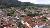 Aerial view of camera flying away from the church on the main plaza in Villa de Leyva, Colombia