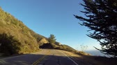 Driving through Big Sur on the California Coast during the golden hour