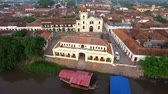 santa magdalena : Aerial view of Mompox, Colombia with the camera flying away from town Stock Footage