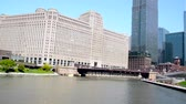 CHICAGO - MAY 12: Coming around a bend in the Chicago River in Chicago on  May 12, 2017 Stock Footage
