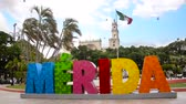 MERIDA, MEXICO - FEBRUARY 21: Colorful Merida sign and Mexican flag in the plaza in Merida, Mexico on February 21, 2017