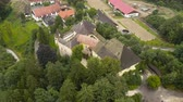 efsanevi : Aerial view of Medieval Castle Halleg in Klagenfurt, Austria, Karyntia. Flight over beautiful castle surrounded by Mountains and forests. Walls covered with ivy. Stok Video