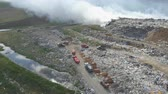 Garbage dump pollutes the environment. Strong wind rises toxic smoke of burning garbage into the air. Wideo