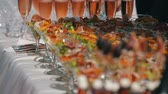 obiad : Reception table with wineglasses fillled with fresh salad. Focus panorama of table served outside Wideo