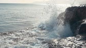 rochoso : Big waves are crashing on rocks and spraying. Beach in Tenerife, Slow motion