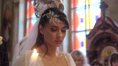 imádkozik : Close-up portrait of bride in the Orthodox Church during the wedding ceremony.