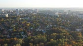 сентябрь : Multicolored fall trees in city park. Autumn Kharkov city aerial view. Beautiful autumn city park and high buildings on the background.