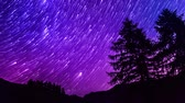 star trails time lapse galaxy night sky over mountain. Blue and purple sky. 4K resolution Wideo