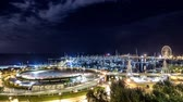 Rimini, Italy - October 08, 2014: night city lights on the marina. Night to day timelapse