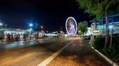 Rimini, Italy - August 22, 2014: summer night street view timelapse with tourist and ferris wheel background in Rimini seafront. 4K video Wideo