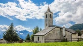 timelapse mountain rural scene. Church belfry. Val dAosta. italy