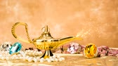 fantezi : The formation of a magical deity from a gold, magic lamp surrounded by a wealth of jewelry and fantasy.