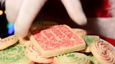 świety mikołaj : Santa Claus takes a Christmas cookie from a plate of sweets left for him by a holiday traditional family. Wideo