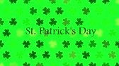 ziyafet : St. Patricks animated clovers against a bright green background. For use as a general backdrop, design element or as an overlay for placement of text or other copy. Stok Video