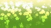 рассеянный : St. Patricks animated clovers against a green and yellow vignette background. For use as a general backdrop, design element or as an overlay for placement of text or other copy.