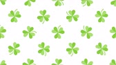 рассеянный : St. Patricks animated clovers against a white background. For use as a general backdrop, design element or as an overlay for placement of text or other copy. Стоковые видеозаписи