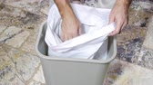atık : A man inserts a fresh, empty trash bag into a trashcan as part of his weekly chores. Stok Video