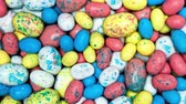 ropogós : A pile of multi colored pastel Easter malt balls for use as a fun, bright background during holiday seasons