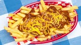 caloria : Delicious fresh, hot chili cheese French fries served in a classic red fast food basket