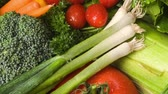 caloria : Pan of a mix of color, fresh, raw organic vegetables with cool water to retain freshness.