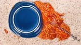 flooring : Pan over an accidently spilled plate of spaghetti on clean carpet leaves a mess for someone to clean up. Stock Footage