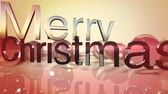 дух : Merry Christmas text forming on defocused Christmas ornament text for use as a seasonal messaging clip