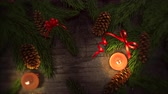 An animated Christmas background with candlelight subtly zooming provides a festive element to holiday messaging and even as a design element where theres plenty of space for copy in advertising seasonal marketing.