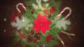 Animated Christmas wreath zooms slowly out while light snow falls. Great for use as is to celebrate the holidays or clip can be used with placement of copy for marketing and messaging. Stock Footage
