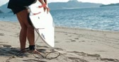 shortboard : Young surfer woman take on leash across leg