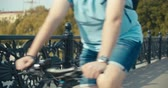 bisiklete binme : Beautiful summertime mood shot of young woman or girl riding bicycle through promenade, in stylish outift, pedalling next to trees in sun light, 4K video shooting slow motion Stok Video
