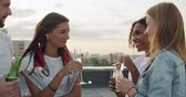 koktajl : Group of happy friends toasting champagne, wine, beer, juice. Friendship concept with young people having fun together. Rooftop party birthday . 4k slow motion raw video footage 60 fps