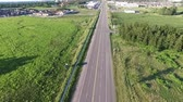 distante : Road Into Town Aerial Stock Footage