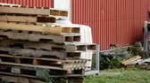 abrigo : 4K Stack Of Wooden Planks In Front Of Red Farmhouse