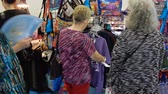saco : 4K Women Shopping For Feline Cat Clothes Purses Stock Footage