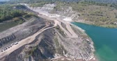 exportação : Aerial Dirt Roads With Trucks From High Altitude Near Mine And Body Of Water 2 Stock Footage