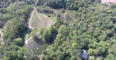 родословная : Flying Over Horse Trails Near Horse Ranch With Large Green Forest Aerial Стоковые видеозаписи