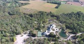 evler : Flying Over Luxury Home With Tennis Court and Water Forest And Trees 2