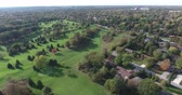 upscale : Golf Course Aerial Suburban Neighborhood With Cityscape Landscape Stock Footage