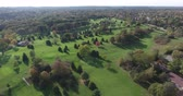 wealthy : Golf Course Green Aerial Flyby With Beautiful Trees