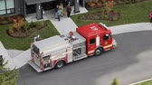 kurtarmak : 4K Firetruck Aerial Fireman Coming Out Of Building People Standing Around Stok Video