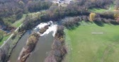 riverbank : Aerial Follow River With Flowing Water And Trees In Autumn Stock Footage